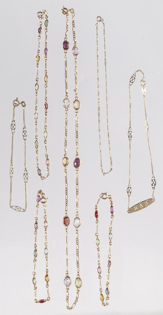 Four multi-colored gemstone and 14K gold pieces,