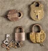Four brass padlocks