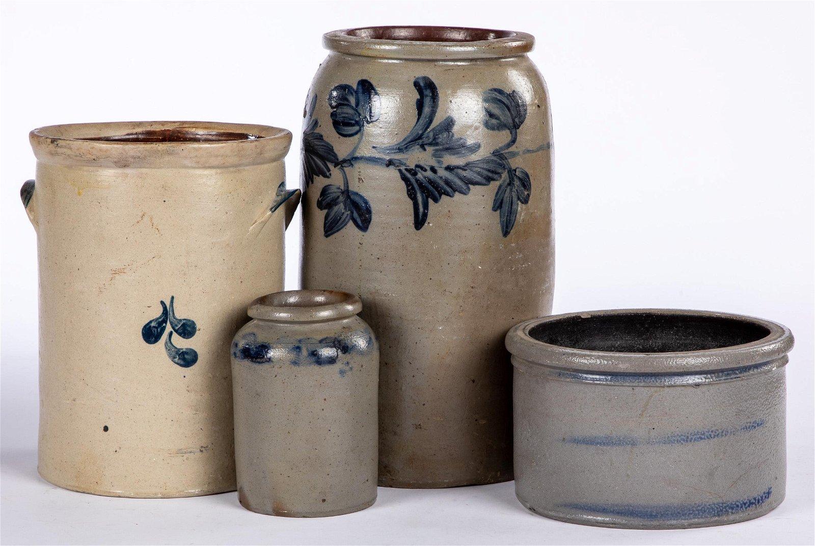 Four cobalt decorated stoneware crocks