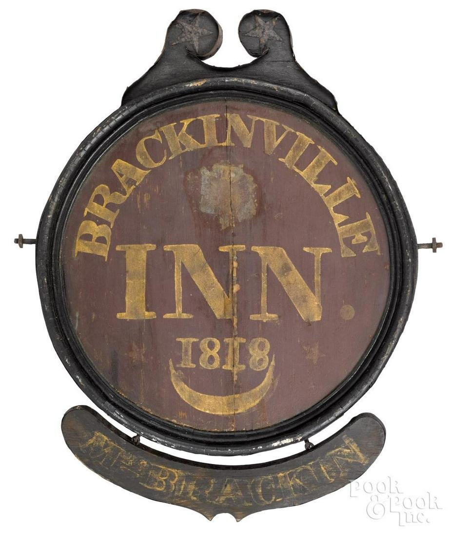 Painted wood and metal trade sign