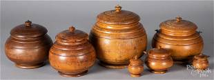 Seven turned peaseware canisters