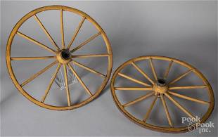 Pair of yellow painted wagon wheels