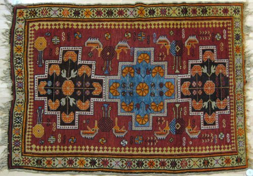 11: Caucasian throw rug, early 20th c., with three