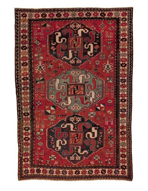 12: Cloudband Kazak throw rug, ca. 1900, with three