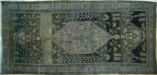 9: Caucasian throw rug, 10' 4'' x 4' 10''.