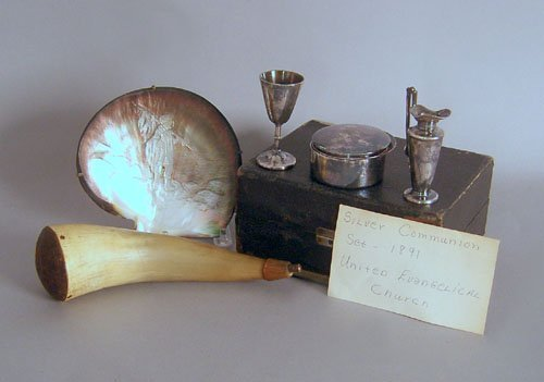 14: Silver plated communion set, together with a carv