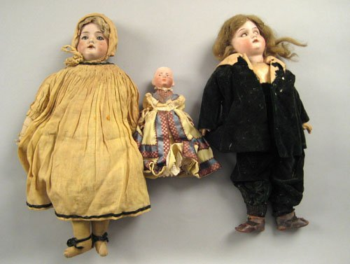 1269: Three early bisque dolls.