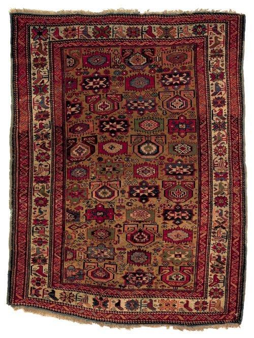 231: Caucasian rug, late 19th c., with geometrics on