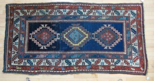 232: Kazak rug, ca. 1910, with three medallions on a
