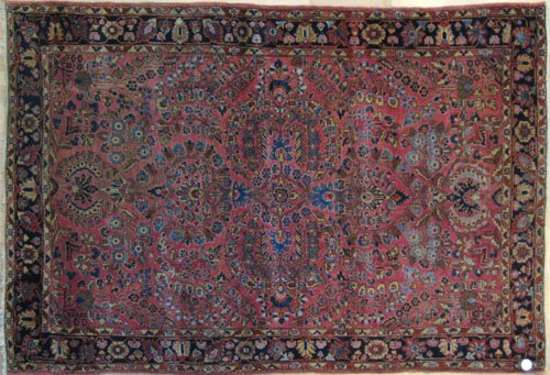 236: Sarouk rug, ca. 1920, with overall floral desig