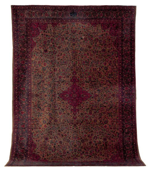 239: Kashan carpet, ca. 1900, with a red medallion o