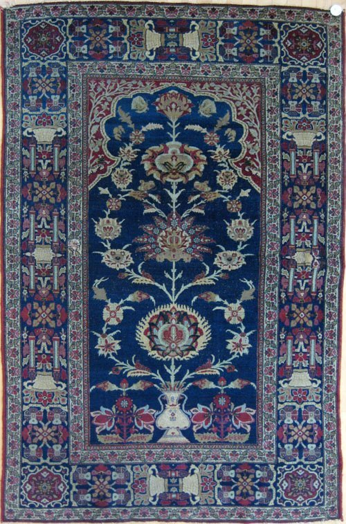 243: Isphahan rug, ca. 1910, the blue field with sty
