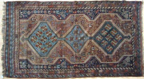 245: Shiraz rug, ca. 1910, with three blue medallion