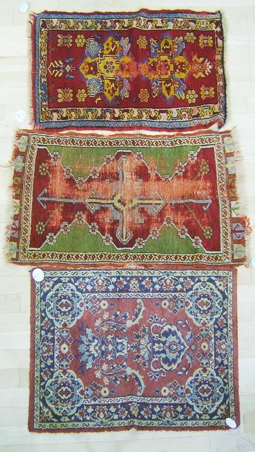 12: Three oriental mats.