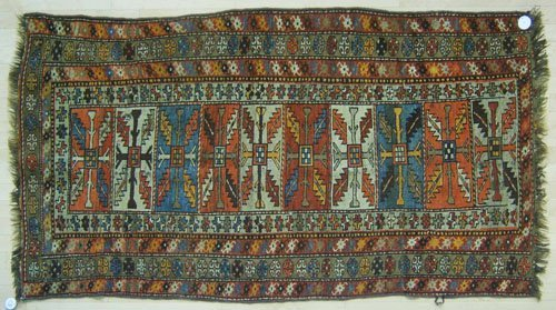 13: Beluch throw rug, 6'4'' x 3'8'', together with a Ca