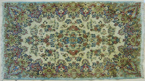 19: Kirman throw rug, 7' x 4'.