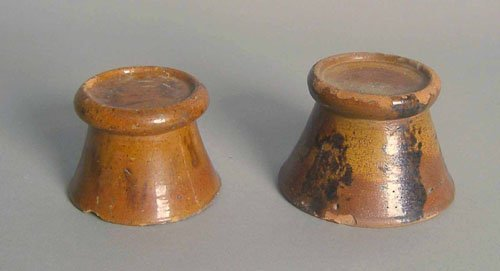 18: Two redware stands, 19th c., 2 3/4'' h. and 3'' h.