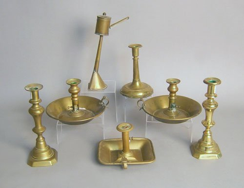 509: Six brass candlesticks, together with an oil lamp