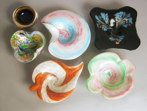 512: Six art glass ashtrays.