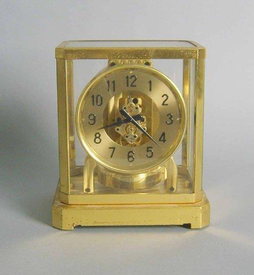 523: Le Coultre Atmos clock, 9 1/4'' h., 7 1/2'' w.