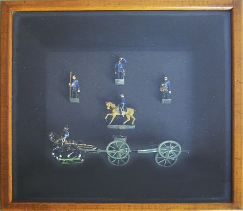 501: Framed group of lead soldiers, 15'' x 14''
