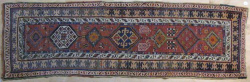 12: Caucasian runner, early 20th c., with medallion