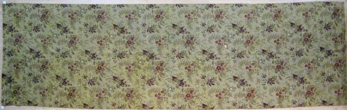 14: Red and yellow ingrain carpet, ca. 1870, in an