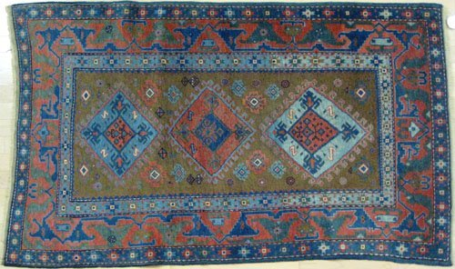 18: Caucasian carpet, early 20th c., with three med