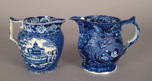 320: Two blue Staffordshire pitchers, 19th c., depic