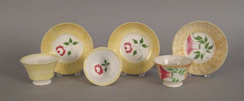 330: Two yellow spatter cups and saucers, 19th c., w