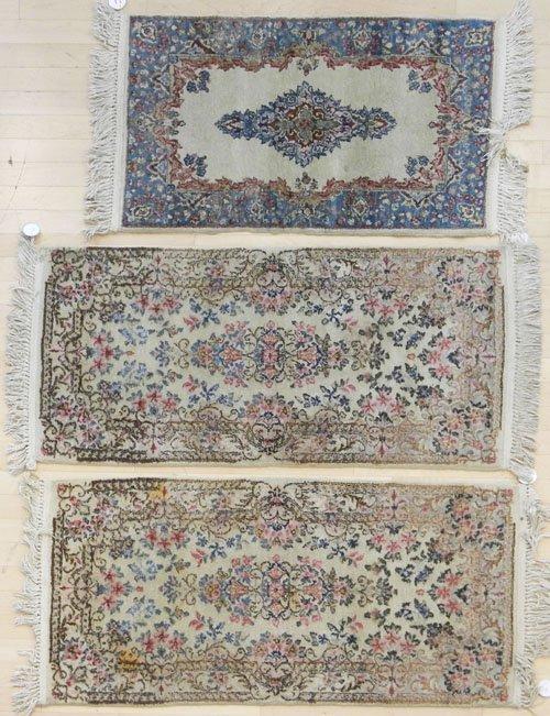 11: Three Kirman mats, 4' 4'' x 2' (2) and 3' 6'' x 2'.