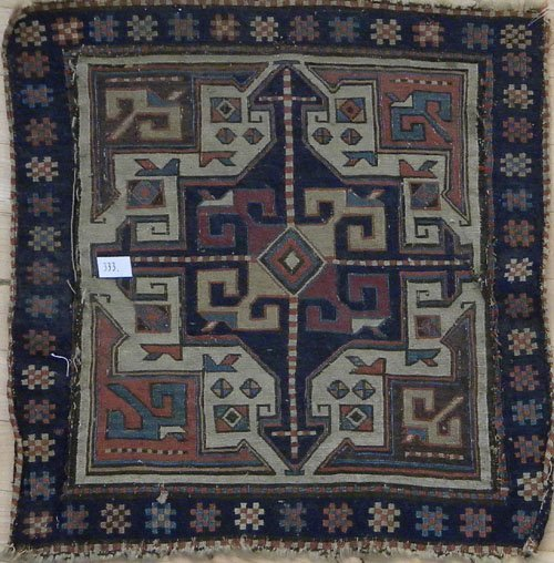 13: Pair of Kilim mats, early 20th c., 21'' x 20''.