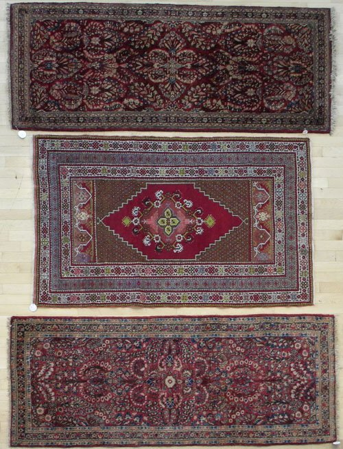 15: Two Sarouk carpets, 6' 7'' x 2' 7''; together with