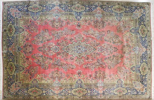 17: Kirman carpet, mid 20th c., 14' 4'' x 10'.