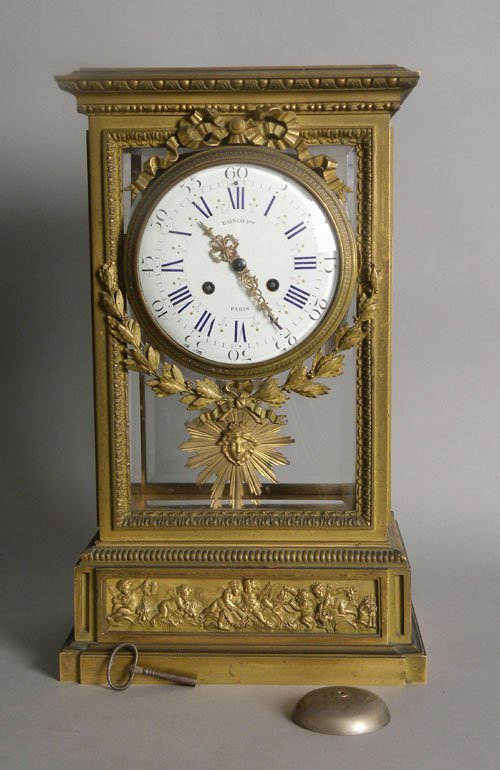 598: French brass mantle clock, ca. 1870, with a bronz