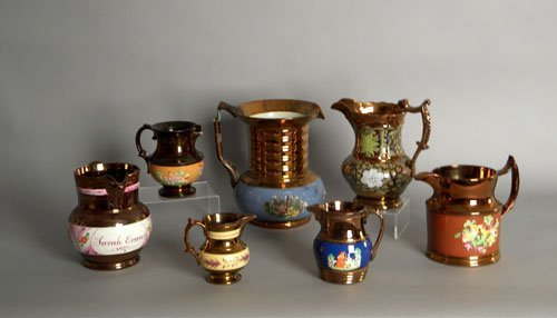 608: Seven copper luster pitchers, 19th c., tallest is