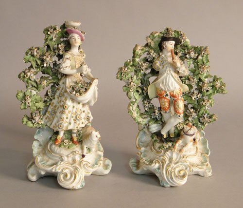 620: Pair of porcelain figural groups, probably late 1
