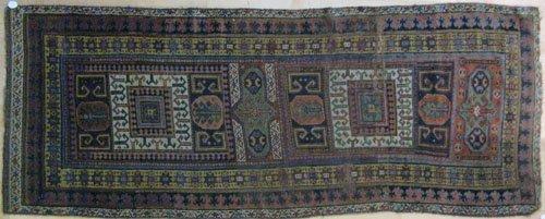 2: Kazak carpet, early 20th c., 9'3'' x 3'6''.