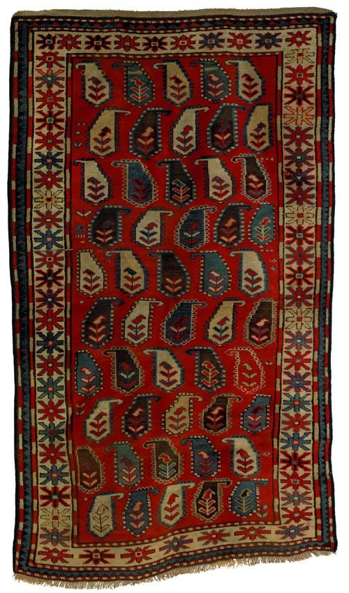 9: Kazak carpet, ca. 1900, with botehs on a red fi