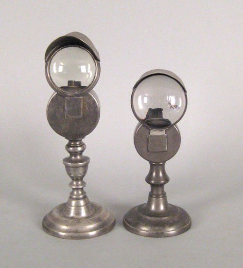 326: Two pewter bull's-eye lamps, 19th c., 8 3/4'' h.