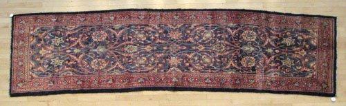 4D: Persian Sarouk carpet, 12' 10'' x 3' 3''.
