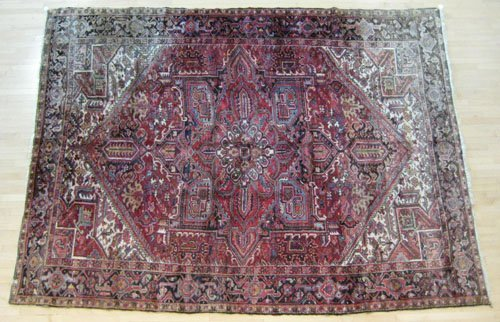 7: Heriz carpet, mid 20th c., 13' x 9' 6''.