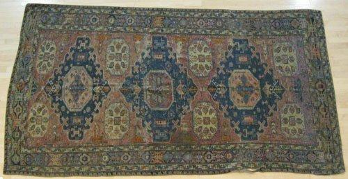 9: Sumac carpet, ca. 1900, 11' x 5' 8'', together wit