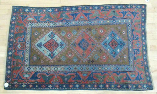 9D: Caucasian carpet, early 20th c., with three medal