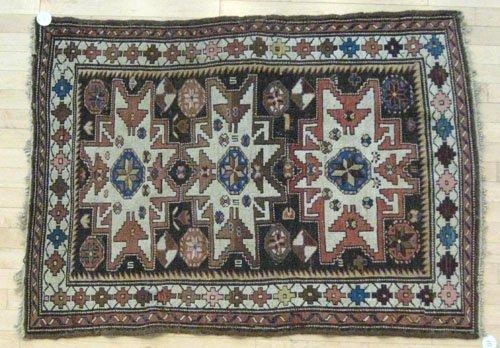 10: Lesghi star carpet, 4' 9'' x 3' 5''.