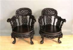 147: Pair of carved Chinese armchairs.