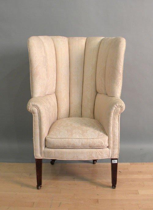 651: English barrel back easy chair.