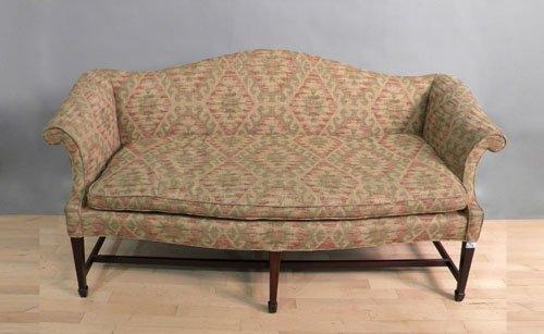 656: George III style mahogany sofa.