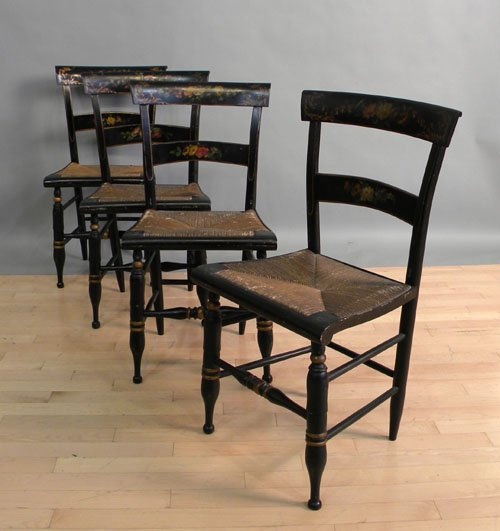 667: Set of four painted rush seat chairs.