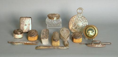 663: Group of sterling silver dresser articles.